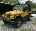 2002 Jeep Wrangler  Yellow 2002 Jeep Wrangler Sport (X) With 4.0  6 cyl. and Automatic Transmission