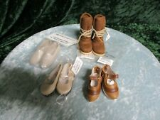 # 33 a selection of 3 doll shoes I think some of these are for little girls.