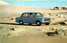 Advertising Postcard 1970 FIAT 124 - in desert w/ camels