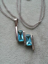 Sterling silver pendant set with 2 Aqua/turquoise CZ's and 18 inch chain