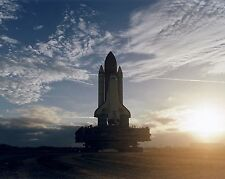 Space Shuttle Discovery rolls out to launch pad at sunrise for STS82 Photo Print