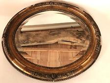 Miroir biseauté ovale cadre stuc doré décor de roses