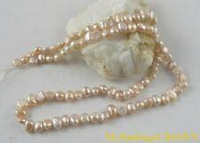 8 strands Mauve rounded flat-sided pearl beads W1837