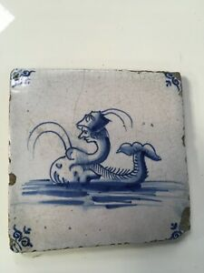 Early Delft tile depicting Mermaid / dolphin 125x125 mm