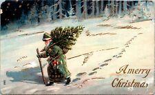 Postcard Embossed Santa Green Robe Carrying Christmas Tree C.1910 L12