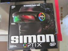 "NIB  ""SIMON OPTIX GAME - THE WEARABLE SIMON GAME"""