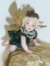 """2.5"""" Artist Made Bisque, Jointed Fairy Baby on Rock in Glass Case"""
