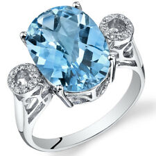 14 Kt White Gold 6.3 cts Swiss Blue Topaz and Diamond Ring R61788