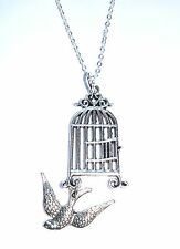 FREE AS A BIRD - open cage pendant with flying swallow drop