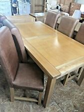 LARGE EXTENDING SOLID OAK DINING TABLE WITH 2 EXTENSIONS & 6 LEATHER CHAIRS