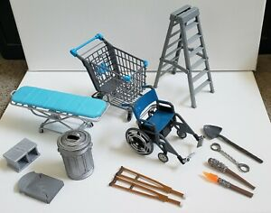 WWE accessories -- wheelchair, shopping cart, gurney, trash can, crutches, more