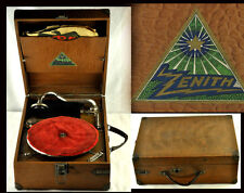 The gramophone is working. Wooden box in good condition, handle is almost thorn. |