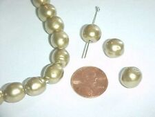24 VINTAGE JAPANESE GLASS GOLD PEARL 11mm. OVAL BEADS L776