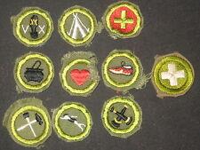 Merit Badges, 10 folded under/crimped, used      TMB06