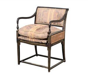 A Las Palmas Design 'Brighton' Parcel Gilt, Ebonized and Cane Paneled Armchair