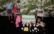 barbie dolls bundle ( with mini babies and musical coat)