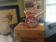 """Wonderful little Tin Toy New in Box - The Cannon"""" lever action spins wheels DL"""