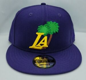 NEW ERA 9FIFTY SNAPBACK HAT.   NBA.   LOS ANGELES LAKERS.   PURPLE.
