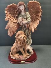 """Montefiori collection 18"""" tall Angel with lamb and lion on wood stand"""