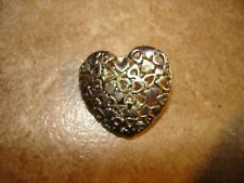 Pierced silver metal heart shape button