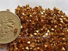 24 x 2 mm x 2 mm SWAROVSKI TOPAZ gold-foiled carrés