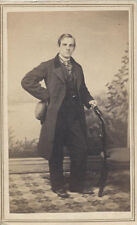 CDV PORTRAIT OF WELL-DRESSED YOUNG MAN W/ PAINTED BACKDROP - NEW YORK CITY, NY
