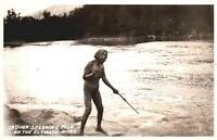 VINTAGE POSTCARD INDIAN SPEARING FISH ON THE KLAMATH RIVER CA RPPC HAS A REPAIR