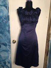 The limited blue sleeveless dress. Size 8. Pre-owned.