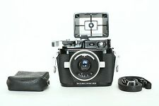 Vintage Nikonos II underwater film camera with W-Nikkor 35mm lens.