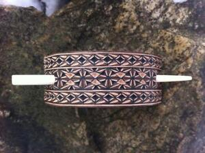 Hand carved leather hair barrette