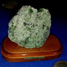 Diopsite mounted on wood display stand from Brazil