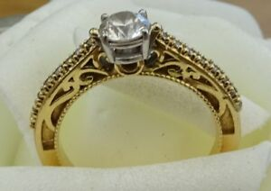 real 18ct yellow white gold scroll sided round solitaire diamond claw set .60ct