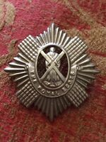 Original, Royal Scots Territorial Cap Badge White Metal Scroll.