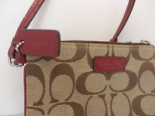 Coach wristlet with scarlett red patent leather strap Logo