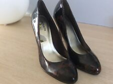 Ladies barratt tortoise effect patent heels size 4