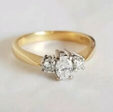 18ct Yellow Gold three stone Dress Ring. Oval Diamond & Brilliant cut Diamonds