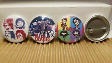 13 Different Beatles Pins.