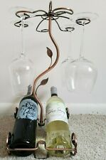 Wine Display Rack - Brand New. Holds up to six glasses and two bottles.