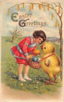 EASTER GREETINGS POSTCARD 1910s~GIRL PUTS COLORFUL EGGS IN BASKET HELD BY CHICK