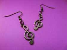 NEW! Musical note / Treble clef - Plated antique Bronze earring in Organza bag.