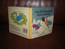 LES SCHTROUMPFS DANS LA NEIGE - 15 X 15 CM CARTONNE PREMIERS LIVRES DUPUIS 1983