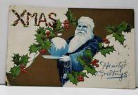 Xmas Hearty Greetings Blue Santa with Globe Gold Finish Emb. 1907 Postcard F15