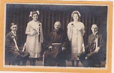 Studio Real Photo Postcard RPPC - Priest with Male and Female Graduates