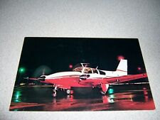 1960s BEECHCRAFT C-55 BARON at NIGHT VTG AIRPLANE DEALER POSTCARD