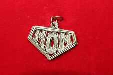 "14 K Y/ GOLD ""MOM"" PENDENT IN SHAPE OF SUPER MOM 2.4 GRAMS"