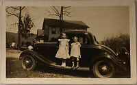 Sisters ~ Two Little Girls Stand On Running Board of Old Automobile ~ Photograph
