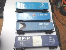 4- 50'   boxcars.   2-Bachmann  & 2- unknown   HO