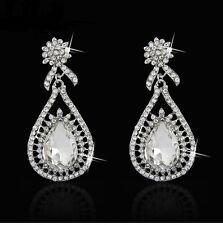A pair of Rhodium Plated Rhinestone Style Bridal Bridal Drop Dangle Earrings