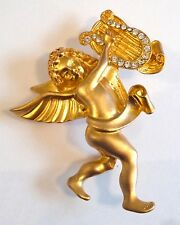 A VINTAGE 1980s SATIN EFFECT GOLD TONE CUPID & HARP BROOCH WITH WHITE DIAMANTES
