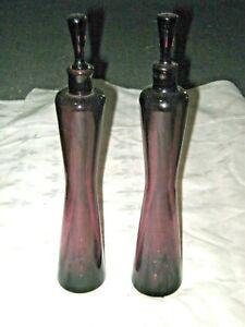 A Pair of Slimline Amethyst Art Glass Genie Style Oil, Vinegar Decanter Bottles